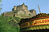 Merry go round and Edinburgh Castle. Edinburgh. Scotland