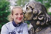 Nicolaus Copernicus statue with girl. Olsztyn. Poland