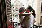Couple kissing passionate after the Chupinazo , with Town Hall at the back. Fiesta de San Fermín. Pamplona. Navarra. Spain.