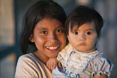 Girls with indigenous features. Iquitos. Peru