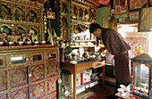 Praying and daily offerings inside a house. Thimpu, Bhutan