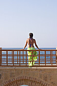 Woman Standing on Bridge in Holiday Resort in Swimming Costume, Red Sea, Egypt