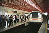 Mass rapid transit train arriving at interchange station. Singapore