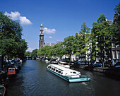 Pleasure boats on an Amsterdam canal. Amsterdam. Holland