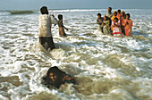 Asia, Asian, Asians, Bathe, Bathes, Bathing, Coast, Coastal, Color, Colour, Daytime, Ethnic, Ethnicity, Exterior, Families, Family, Foam, Foamy, Froth, Group, Groups, Horizontal, Human, India, Indian, Indians, Leisure, Outdoor, Outdoors, Outside, People,