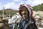 Worker at the olive oil factory. Jerash, Jordan