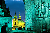 Tower of Mala Strana bridge and domes of St. Nichola s church. Prague. Czech Republic