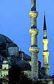 Blue mosque minarets illuminated at night. Istanbul. Turkey