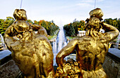 Golden statues, water works and perspective on the canal to Baltic Sea at Peterhof Park. Petrodvorets, St. Petersburg. Russia