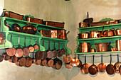 Copper cooking utensils in the kitchen of Château de Champchevrier. Touraine, Val-de-Loire. France