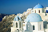 Ia village. Churches Domes and belfries painted in blue. Santorini. Greece