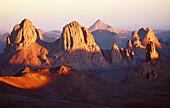 Atakor Mountains seen from father Charles de Foucault ermitage at sunset. Assekrem col. Hoggar, Sahara desert. Algeria