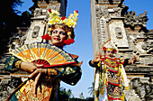 Young female LeGong dancer and Baris dancer in a temple. Bali island. Indonesia (Model released)
