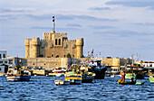 The Alexandria bay with Quaitbay fortress at back. Alexandria. Egypt