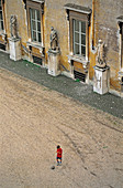 Boy playing football in the yard of Villa Medici. Rome, Italy