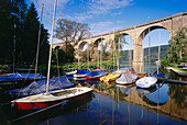 Railroad viaduct over harbor for sailboats at river Ruhr, Herdecke, Northrhine-Westphalia, Germany