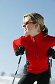 Woman leaning on ski poles, Styria, Austria