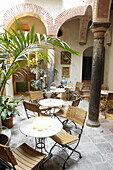 Andalucia, Andalusia, Arch, Arches, Bar, Bars, Cadiz province, Cafe, Cafe terrace, Cafe terraces, Cafes, Chair, Chairs, Coffee shop, Coffee shops, Color, Colour, Column, Columns, Courtyard, Courtyards, Daytime, Europe, Exterior, Facilities, Hotel, Hotels