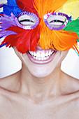 Adult, Adults, Carnival, Carnivals, Caucasian, Caucasians, Color, Colour, Contemporary, Expressive, Expressiveness, Exuberance, Exuberant, Facial expression, Facial expressions, Fantasy, Feather, Feathers, Female, Festival, Festivals, Grin, Grinning, Hap