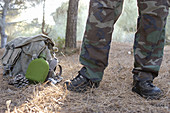 Anonymous, Backpack, Backpacks, Boot, Boots, Camouflage clothes, Canteen, Canteens, Color, Colour, Contemporary, Country, Countryside, Daytime, Detail, Details, Exterior, Feet, Foot, Horizontal, Human, Leg, Legs, Military, Nature, One, One person, Outdoo