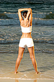 Adult, Adults, Back view, Beach, Beaches, Calisthenics, Callisthenics, Casual, Coast, Coastal, Color, Colour, Contemporary, Daytime, Exercise, Exercises, Exterior, Female, Fit, Fitness, Full-body, Full-length, Health, Healthy, Human, Informal, One, One p