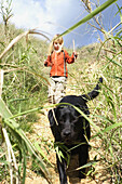 young child and labrador