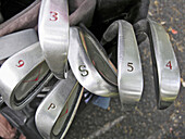 Arrangement, Close up, Close-up, Closeup, Color, Colour, Concept, Concepts, Daytime, Detail, Details, Equipment, Exterior, Golf, Golf club, Golf clubs, Horizontal, Howson, Metal, Number, Numbers, Object, Objects, Order, Outdoor, Outdoors, Outside, Sport,