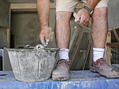 Ability, Activity, Adult, Adults, Anonymous, Bricklayer, Bricklayers, Bucket, Buckets, Color, Colour, Construction, Detail, Details, Dexterity, Horizontal, Human, Indoor, Indoors, Inside, Interior, Leg, Legs, Male, Man, Men, Men only, One, One person, Pe