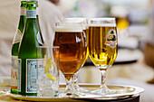 Alcohol, Alcoholic drink, Alcoholic drinks, Bar, Bars, Beer, Beverage, Beverages, Bottle, Bottles, Close up, Close-up, Closeup, Color, Colour, Concept, Concepts, Cool, Daytime, Drink, Drinks, Exterior, Foam, Foamy, Fresh, Freshness, Froth, Frothing, Glas