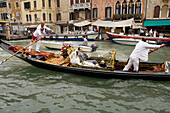 Boat, Boats, Canal, Canals, Cities, City, Cityscape, Cityscapes, Color, Colour, Couple, Couples, Daytime, Dress, Dresses, Europe, Exterior, Gondola, Gondolas, Gondolier, Gondoliers, Grand Canal, Italy, Motion, Movement, Moving, Outdoor, Outdoors, Outside