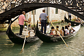 Back view, Boat, Boats, Bridge, Bridges, Canal, Canals, Cities, City, Cityscape, Cityscapes, Color, Colour, Daytime, Europe, Exterior, Gondola, Gondolas, Gondolier, Gondoliers, Grand Canal, Italy, Motion, Movement, Moving, Outdoor, Outdoors, Outside, Rea