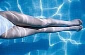 ars, Adult, Adults, Bathe, Bathes, Bathing, Bathing suit, Bathing suits, Blue, Body, Body part, Body