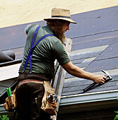 Amish carpenter at work. Pennsylvania, USA