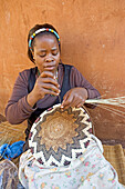 Mr Alfred village chief daughter at work with vannery. Traditional zulu craft center of Thembalethu. Kwazulu-Natal province. South Africa