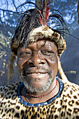 The Chief Biyela dressed with his ceremonial leopard skin . Simunye zulu village where visitors can be accomodated in zulu style. Kwazulu-Natal province. South Africa