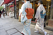 Women dressed in traditional kimono passing by in Ginza. Tokyo. Japan