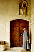 Nun entering abbey. Manche, Normandy, France