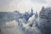 Smoke covers City Hall square during Mascletà fire works, Fallas festival. Valencia. Spain