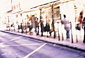 Blurred, Bus stop, Bus stops, Color, Colour, Concept, Concepts, Daytime, Exterior, Human, Many, Motion, Movement, Moving, Outdoor, Outdoors, Outside, People, Person, Persons, Public transport, Public transportation, Special effects, Stand, Standing, Stre