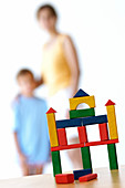 Adult, Adults, Architecture, Balance, Block, Blocks, Blue, Boy, Boys, Building, Buildings, Casual, Child, Childhood, Children, Color, Colored, Colorful, Colors, Colour, Coloured, Colourful, Colours, Construction, Contemporary, Creative, Creativity, Equil