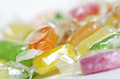Candies, Candy, Childhood, Close up, Close-up, Closeup, Color, Colour, Concept, Concepts, Food, Horizontal, Indoor, Indoors, Infantile, Inside, Interior, Nourishment, Plastic, Selective focus, Still life, Sweet, Sweets, Wrapped, B19-317881, agefotostock