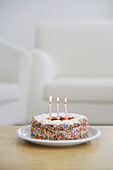 Aliment, Aliments, Birthday cake, Birthday cakes, Birthday parties, Birthday party, Burn, Burning, Candle, Candles, Childhood, Color, Colour, Concept, Concepts, Desire, Desires, Food, Foodstuff, Indoor, Indoors, Infantile, Inside, Interior, One, Positive