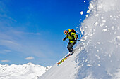 Skier in deep snow, Heliskiing, Kamchatka Peninsula, Sibiria, Russia