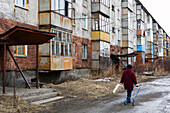 Concrete buildings and person on the street, Yelizovo, close to Petropavlovsk, Kamchatka, Sibiria, Russia