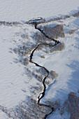 Kamchatka, Sibiria, a little creek, river in a snowy landscape