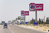 Ad billboards along the road from Cairo to Alexandria. Egypt