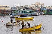 Fishermen boats along the sea side Corniche near the fishmarket. City of Alexandria. Egypt
