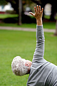 Adult, Adults, Agile, Agility, Arm, Arms, Calisthenics, Callisthenics, Caucasian, Caucasians, Color, Colour, Contemporary, Daytime, Exercise, Exterior, Female, Fit, Fitness, Gesture, Gestures, Gesturing, Gray-haired, Grey-haired, Health, Healthy, Human,