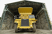 Dumper-truck unloading marl at quarry, cement plant