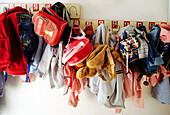 Backpack, Backpacks, Childhood, Color, Colour, Concept, Concepts, Detail, Details, Disorder, Elementary school, Garment, Grade School, Hang, Hanger, Hangers, Hanging, Horizontal, Indoor, Indoors, Infantile, Inside, Interior, Many, Mess, Messy, Varied, Va
